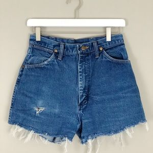 Wrangler Shorts - Distressed High Rise Wrangler shorts w/ raw hem 25